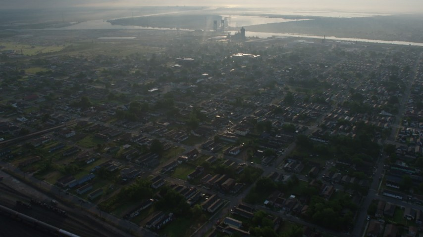 4K stock footage aerial video of flying over urban neighborhoods in the Upper Ninth Ward at sunrise, New Orleans, Louisiana Aerial Stock Footage | PVED01_058