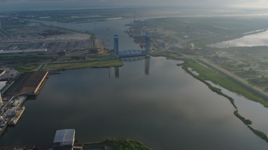 4K stock footage aerial video orbit the Florida Avenue Bridge spanning Industrial Canal in New Orleans at sunrise, Louisiana Aerial Stock Footage | PVED01_060