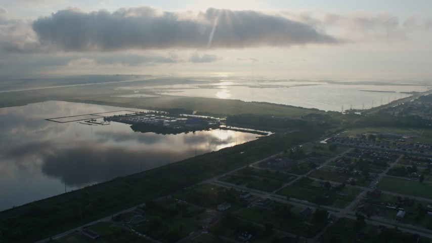 4K aerial video fly over Lower Ninth Ward Neighborhoods toward water treatment plant at sunrise in New Orleans, Louisiana Aerial Stock Footage PVED01_061