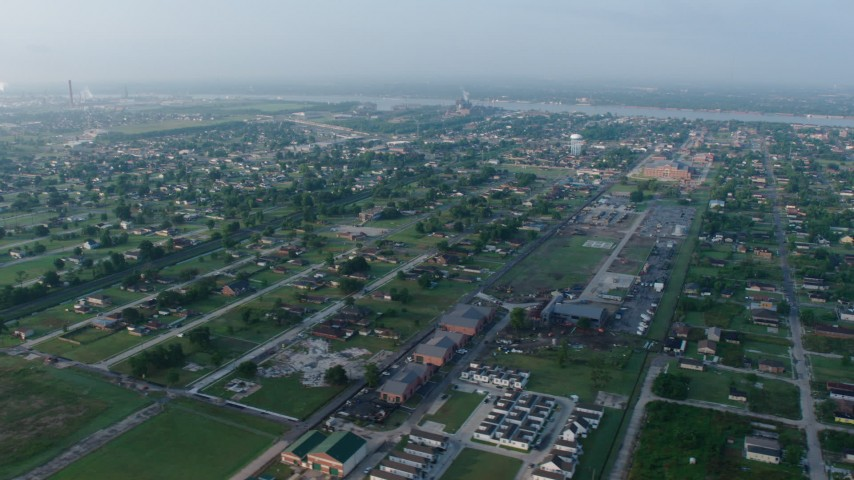 4K aerial video orbit urban residential neighborhoods in the Lower Ninth Ward of New Orleans at sunrise, Louisiana Aerial Stock Footage | PVED01_062