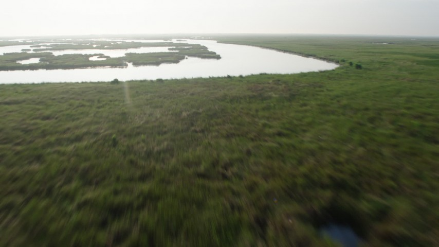 4K stock footage aerial video tilt and fly low over marshland and bayou in St. Bernard Parish, Louisiana at sunrise Aerial Stock Footage | PVED01_071
