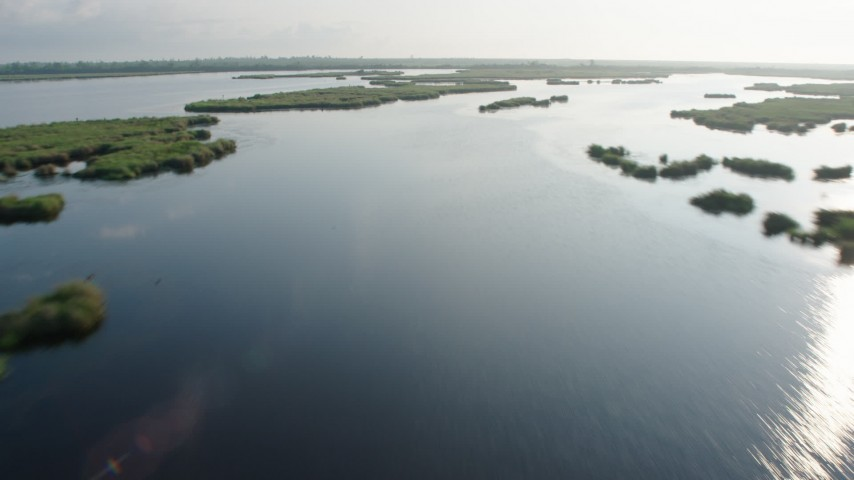 4K stock footage aerial video fly low over bayou and patchy marshland at sunrise in St. Bernard Parish, Louisiana Aerial Stock Footage | PVED01_072