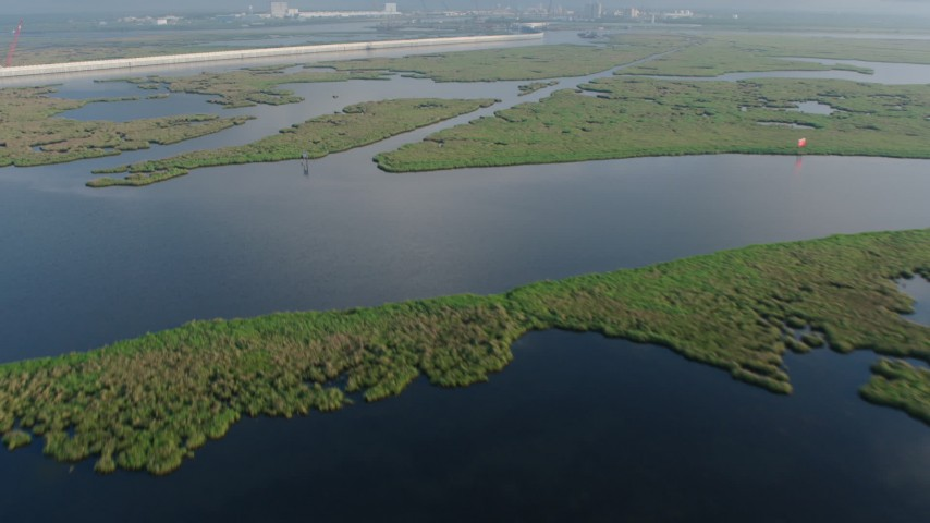 4K stock footage aerial video fly over patches of bayou marshland at sunrise in St. Bernard Parish and reveal surge barrier, Louisiana Aerial Stock Footage | PVED01_075