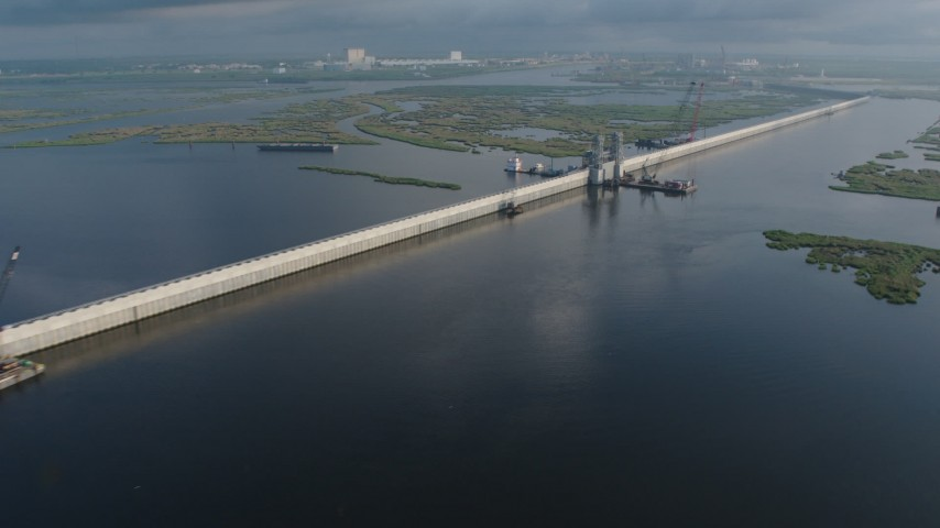 4K stock footage aerial video flying by a section of surge barrier and a gate in St. Bernard Parish at sunrise, Louisiana Aerial Stock Footage | PVED01_078