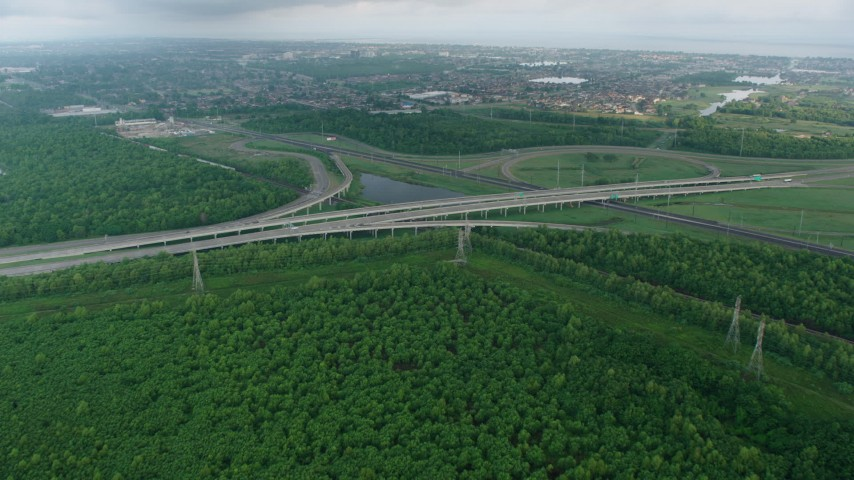 4K aerial video fly over freeway interchange to approach a New Orleans East suburb at sunrise, Louisiana Aerial Stock Footage | PVED01_084
