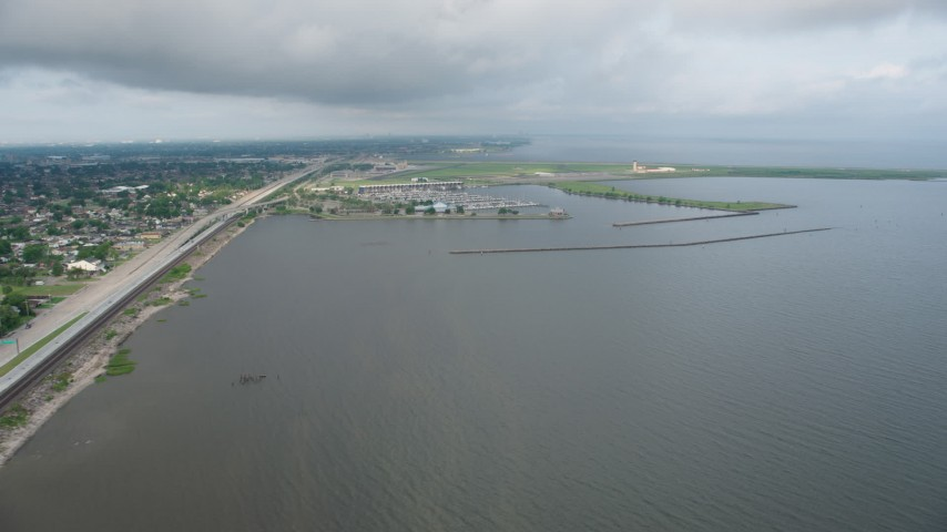 4K stock footage aerial video wide orbit of a marina on Lake Pontchartrain at sunrise in Louisiana Aerial Stock Footage | PVED01_090