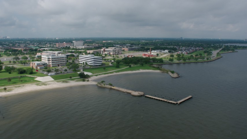 4K stock footage aerial video flying by office and apartment buildings on the shore of Lake Pontchartrain in Gentilly, Louisiana Aerial Stock Footage | PVED01_093