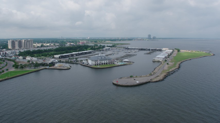 4K stock footage aerial video orbit marina and Breakwater Park on Lake Pontchartrain Shore in Lakeview, New Orleans, Louisiana Aerial Stock Footage | PVED01_095