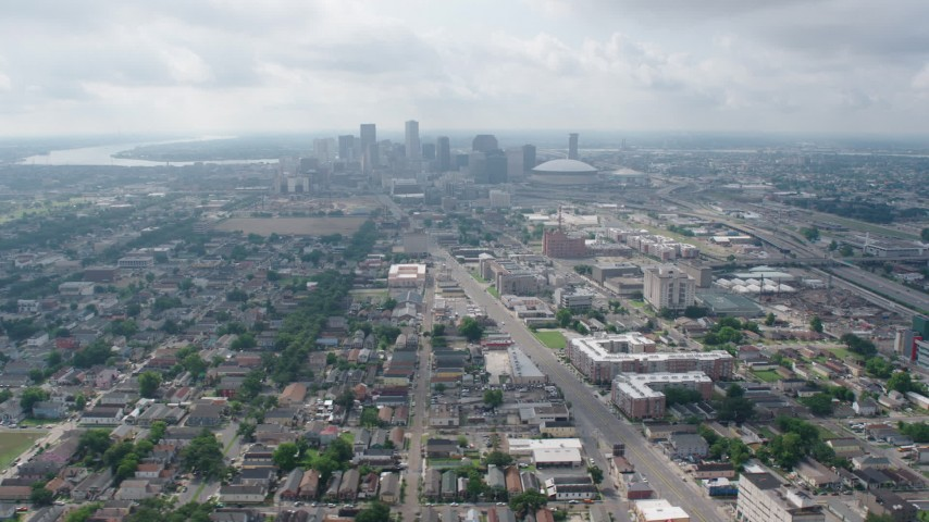 4K stock footage aerial video wide orbit of Mid-City streets to the Downtown skyline of New Orleans, Louisiana Aerial Stock Footage | PVED01_109