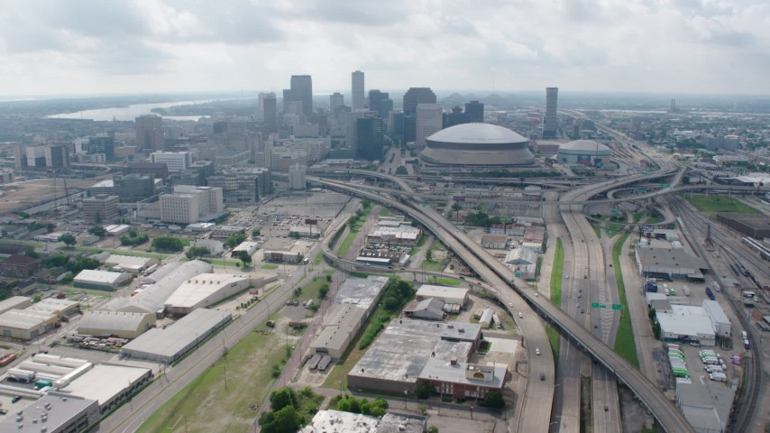 4K aerial video tilt from Interstate 10 in Mid-City to reveal Downtown skyline of New Orleans, Louisiana Aerial Stock Footage | PVED01_110