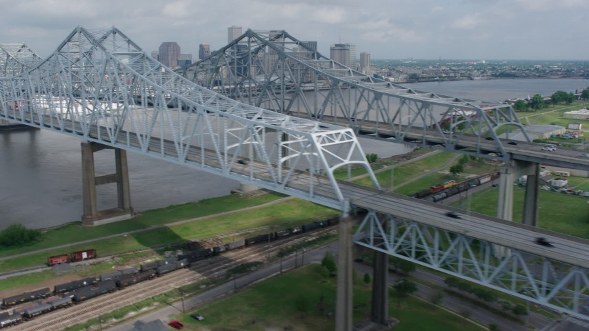 4K aerial video flyby Crescent City Connection Bridge and reveal Downtown New Orleans skyline, Louisiana Aerial Stock Footage | PVED01_113