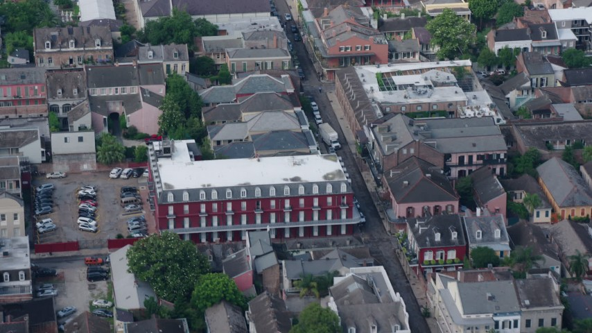 4K stock footage aerial video fly over French Quarter apartment building and street in New Orleans, Louisiana Aerial Stock Footage | PVED01_118