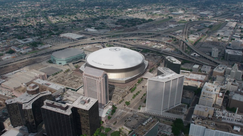 4K aerial video orbit the Superdome and New Orleans Arena in Downtown New Orleans, Louisiana Aerial Stock Footage | PVED01_123