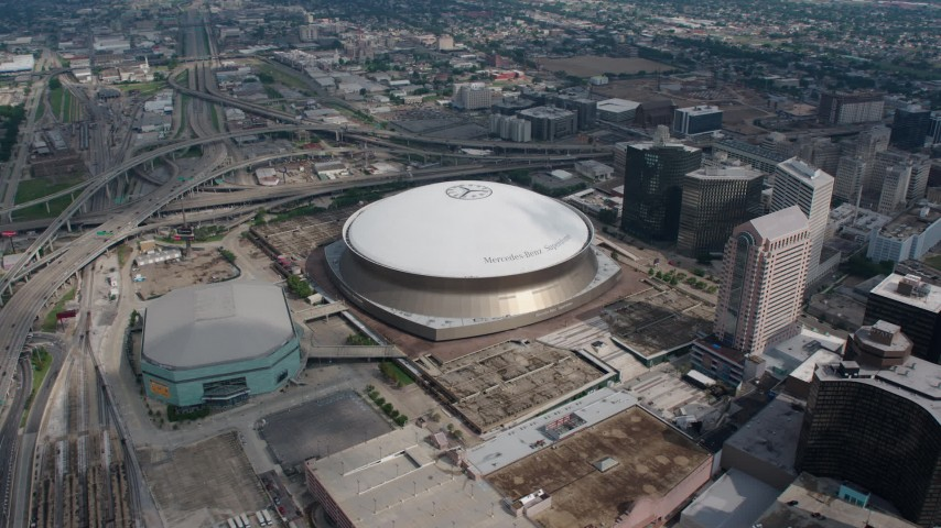 4K aerial video slow orbit of the Superdome and New Orleans Arena in Downtown New Orleans, Louisiana Aerial Stock Footage | PVED01_124