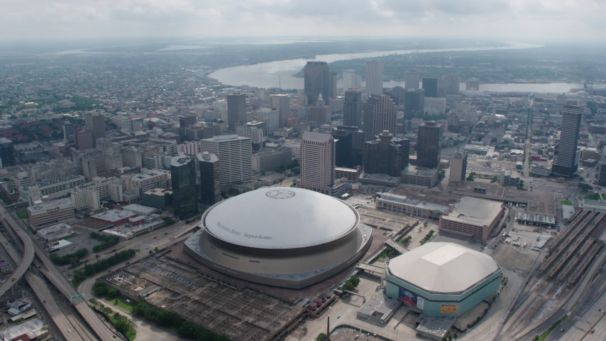 4K stock footage aerial video fly over Superdome and approach Downtown New Orleans skyscrapers, Louisiana Aerial Stock Footage | PVED01_126