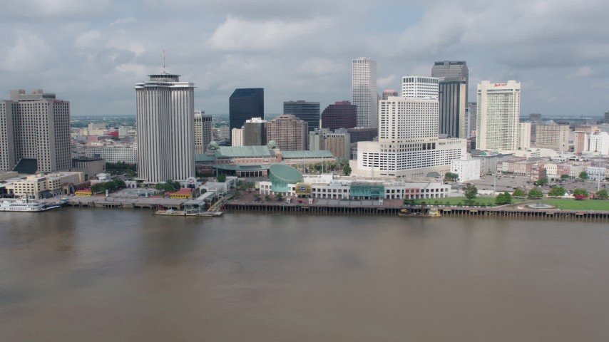 4K aerial video tilt to reveal Downtown New Orleans riverfront skyscrapers, Louisiana Aerial Stock Footage | PVED01_130