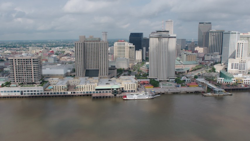 4K aerial video flyby Downtown New Orleans to reveal Cruise Ship at port and the Crescent City Connection, Louisiana Aerial Stock Footage | PVED01_131