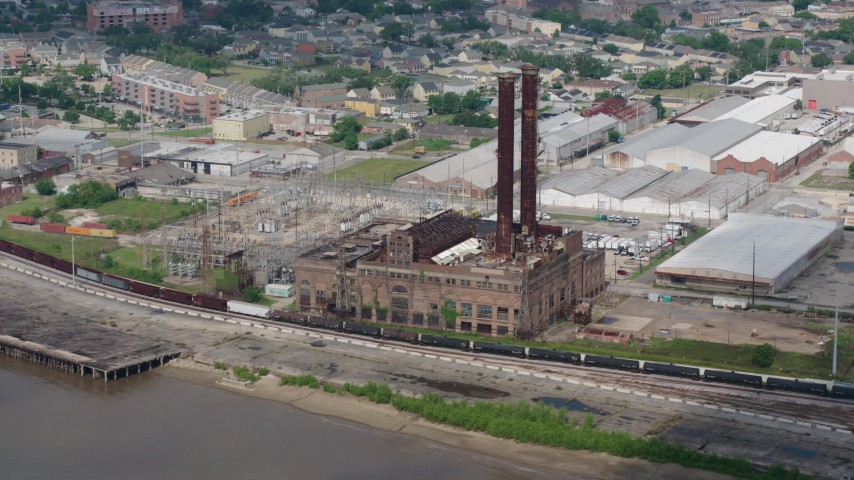 4K stock footage aerial video approach riverfront power plant in the Garden District of New Orleans, Louisiana Aerial Stock Footage PVED01_132 | Axiom Images