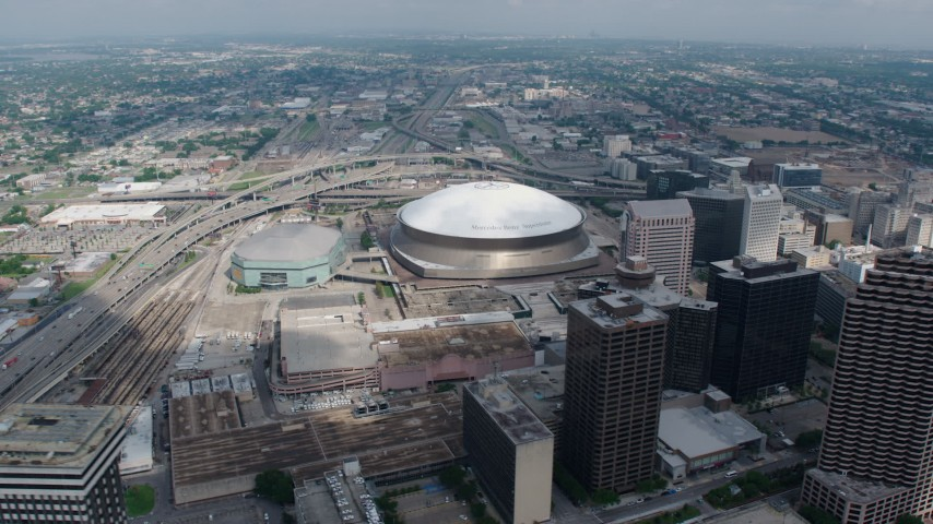 4K stock footage aerial video orbiting the Louisiana Superdome and the New Orleans Arena in Downtown New Orleans, Louisiana Aerial Stock Footage | PVED01_139
