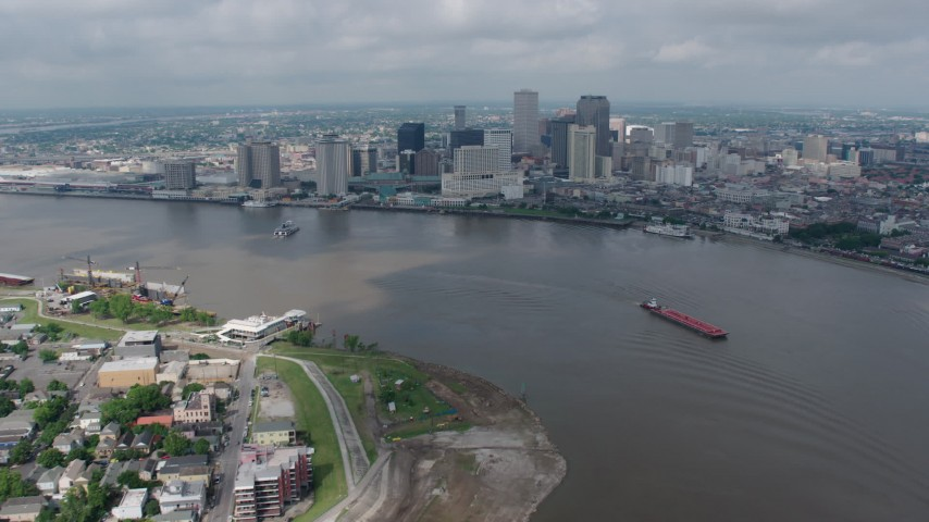 4K aerial video fly over Mississippi River to approach Downtown New Orleans, Louisiana Aerial Stock Footage | PVED01_143
