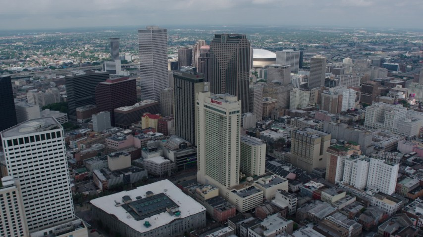 4K aerial video fly over hotels and skyscrapers in Downtown New Orleans to reveal Superdome, Louisiana Aerial Stock Footage | PVED01_144