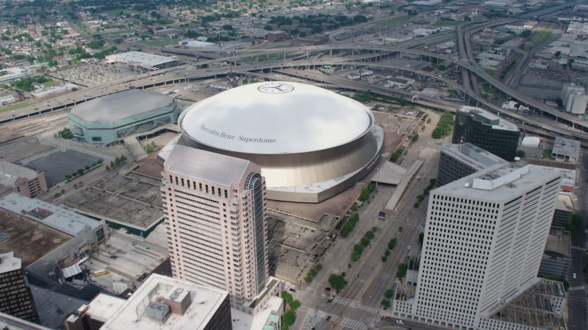 4K aerial video approach and fly over Superdome and freeway interchange in Downtown New Orleans, Louisiana Aerial Stock Footage | PVED01_145