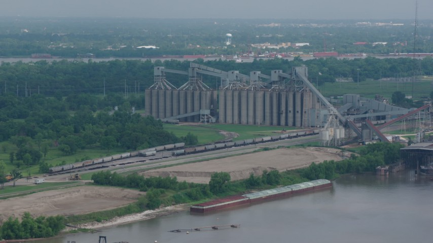 4K stock footage aerial video factory silos on the shore of the Mississippi River in New Orleans, Louisiana Aerial Stock Footage | PVED01_151