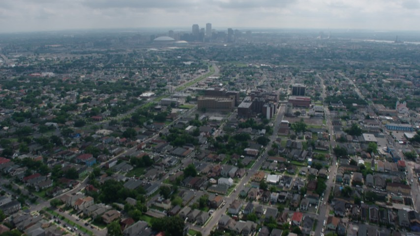 4K aerial video tilt from Uptown suburbs to reveal Downtown New Orleans skyline, Louisiana Aerial Stock Footage | PVED01_154