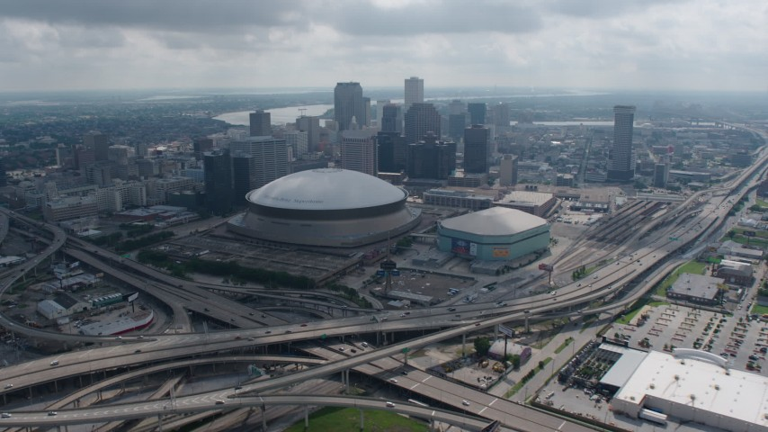 4K aerial video approach the Superdome and Downtown New Orleans from the Garden District, Louisiana Aerial Stock Footage | PVED01_157