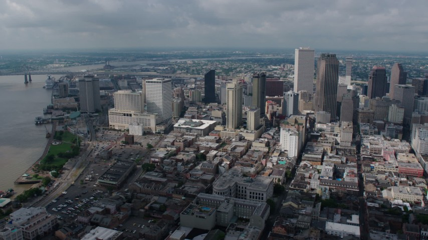 4K aerial video wide orbit of Downtown New Orleans, and reveal St. Louis Cathedral, Louisiana Aerial Stock Footage PVED01_160