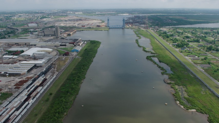 4K stock footage aerial video fly over Industrial Canal toward Florida Avenue Bridge in New Orleans, Louisiana Aerial Stock Footage | PVED01_164