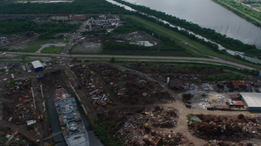 4K aerial video urban neighborhood and canal in Lower Ninth Ward, tilt to reveal industrial area on Industrial Canal, Louisiana Aerial Stock Footage | PVED01_166