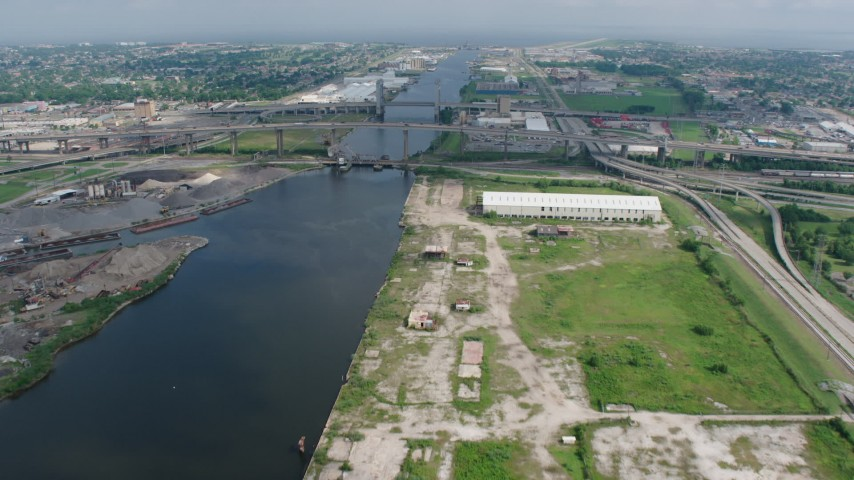 4K stock footage aerial video approach small bridges and factory in New Orleans East, Louisiana Aerial Stock Footage | PVED01_167