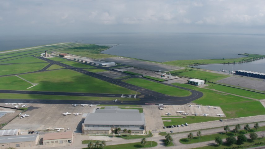 4K stock footage aerial video fly over New Orleans Lakefront Airport to approach Lake Pontchartrain, Louisiana Aerial Stock Footage | PVED01_170