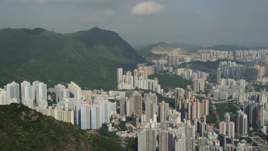 5K stock footage aerial video pan across groups of apartment high-rises in Kowloon, Hong Kong, China Aerial Stock Footage | SS01_0003