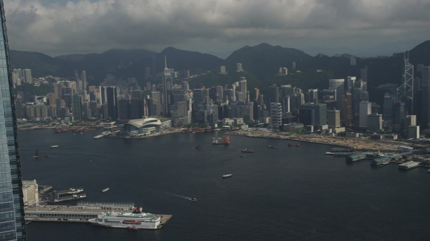 Pan Across Hong Kong Island High-Rises and Waterfront Office Buildings in Kowloon in China Aerial Stock Footage | SS01_0007