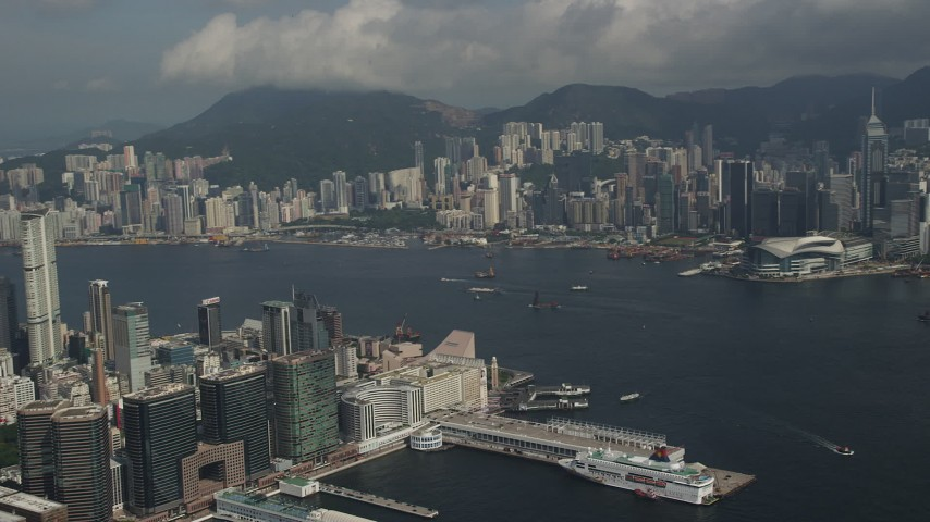 5K stock footage aerial video pan across Hong Kong Island high-rises and waterfront office buildings in Kowloon, Hong Kong, China Aerial Stock Footage | SS01_0007