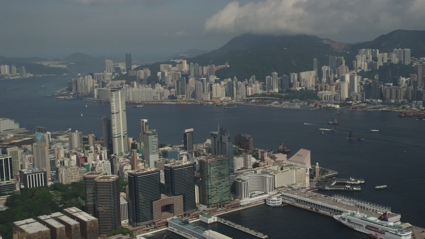 5K stock footage aerial video of Kowloon waterfront office buildings and Victoria Harbor in Hong Kong, China Aerial Stock Footage | SS01_0008