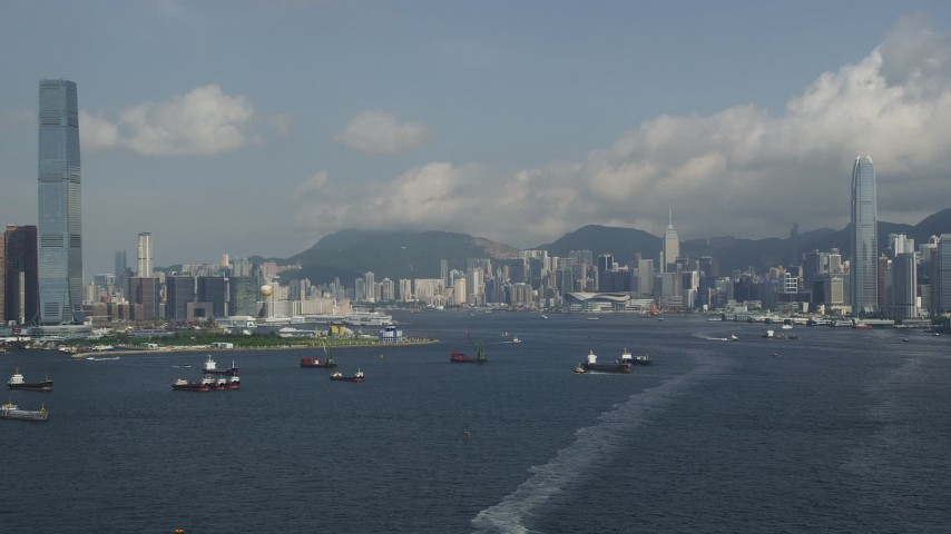 5K stock footage aerial video approach Hong Kong Island waterfront skyscrapers from Victoria Harbor in Hong Kong, China Aerial Stock Footage | SS01_0011