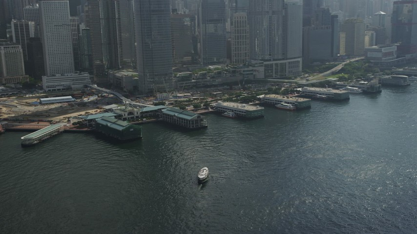 5K stock footage aerial video flyby piers and tilt to skyscrapers on Hong Kong Island, China Aerial Stock Footage | SS01_0014