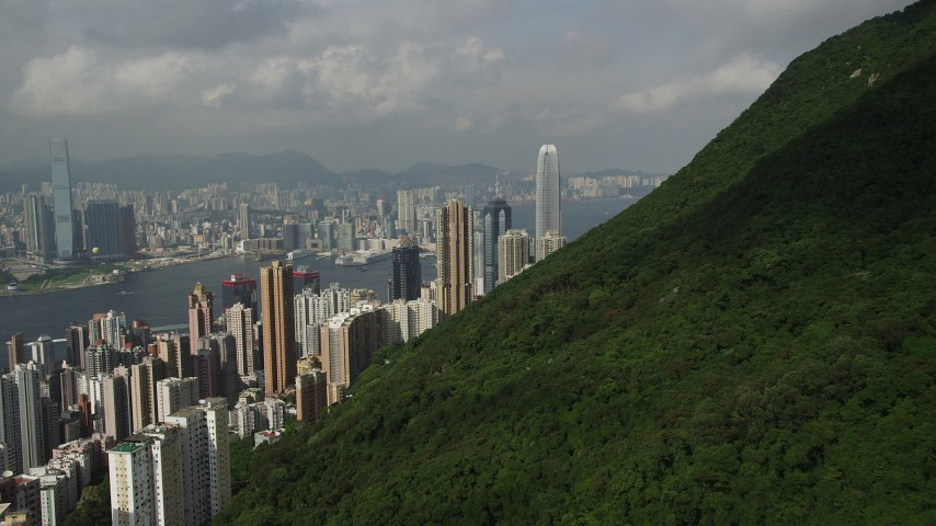 5K stock footage aerial video approach Hong Kong Island skyscrapers seen from a green mountain in China Aerial Stock Footage | SS01_0035