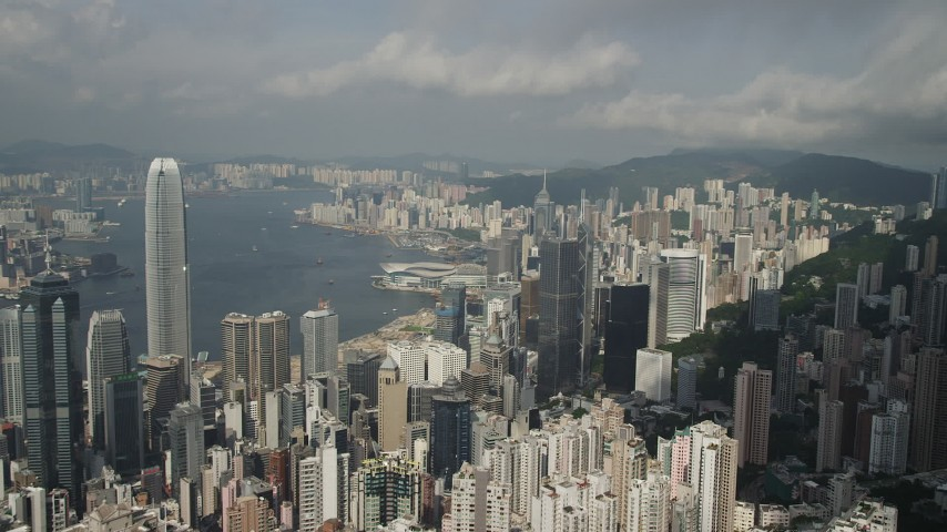 5K stock footage aerial video fly over high-rises to approach skyscrapers on the shore of Hong Kong Island, China Aerial Stock Footage | SS01_0037