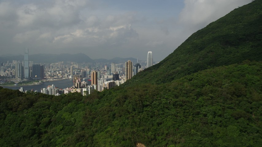 Approach Skyscrapers on Hong Kong Island from Green Mountains Aerial Stock Footage | SS01_0039