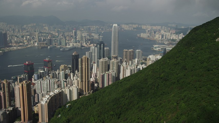 5K stock footage aerial video approach Hong Kong Island high-rises from green mountains in China Aerial Stock Footage | SS01_0040