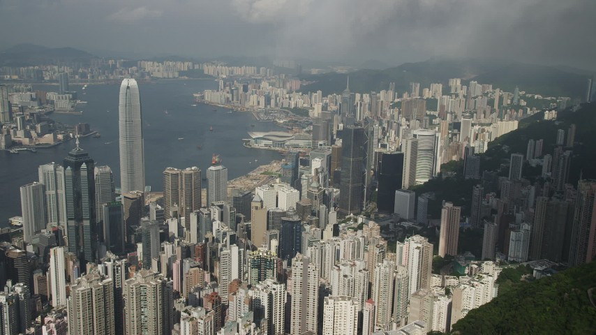 5K stock footage aerial video approach and pan across Hong Kong Island skyscrapers seen from green mountains, China Aerial Stock Footage | SS01_0041