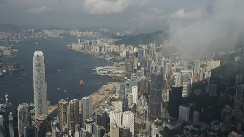 5K stock footage aerial video approach skyscrapers, convention center and harbor on Hong Kong Island, China Aerial Stock Footage | SS01_0042