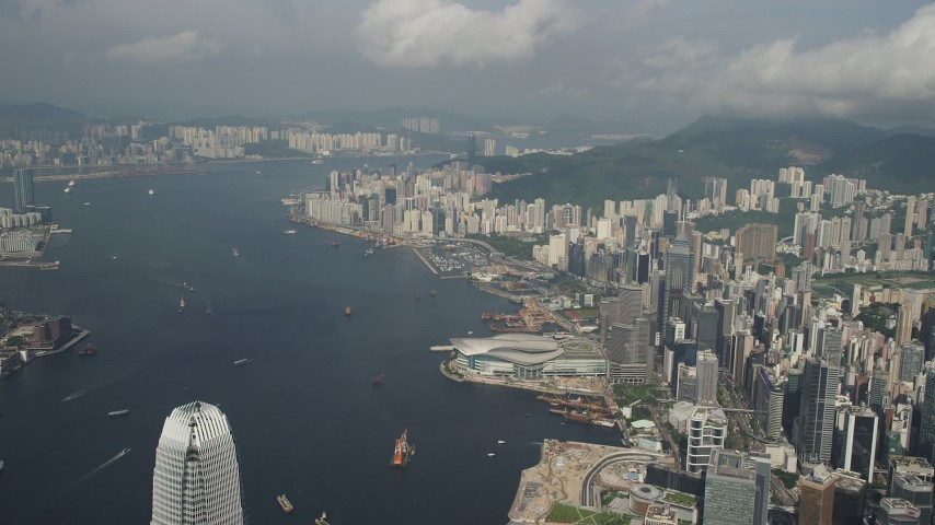 5K stock footage aerial video of Victoria Harbor and waterfront convention center on Hong Kong Island, China Aerial Stock Footage | SS01_0044