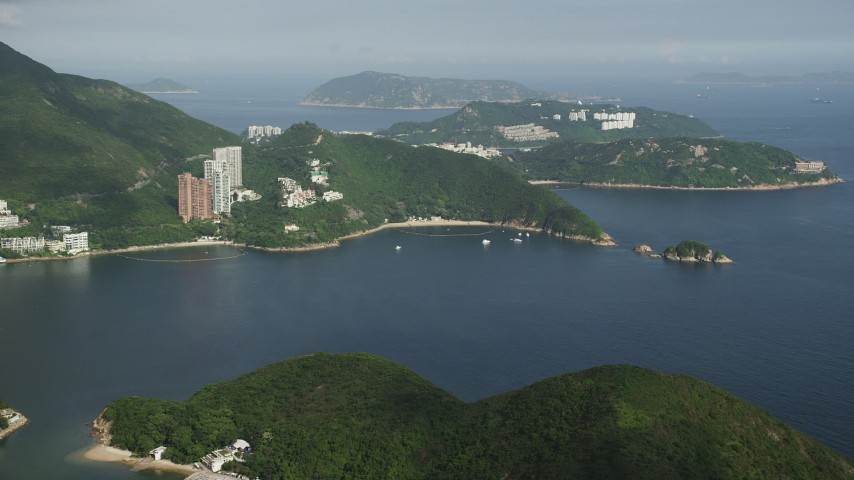 5K stock footage aerial video approach Repulse Bay and waterfront apartment buildings on Hong Kong Island, China Aerial Stock Footage | SS01_0053