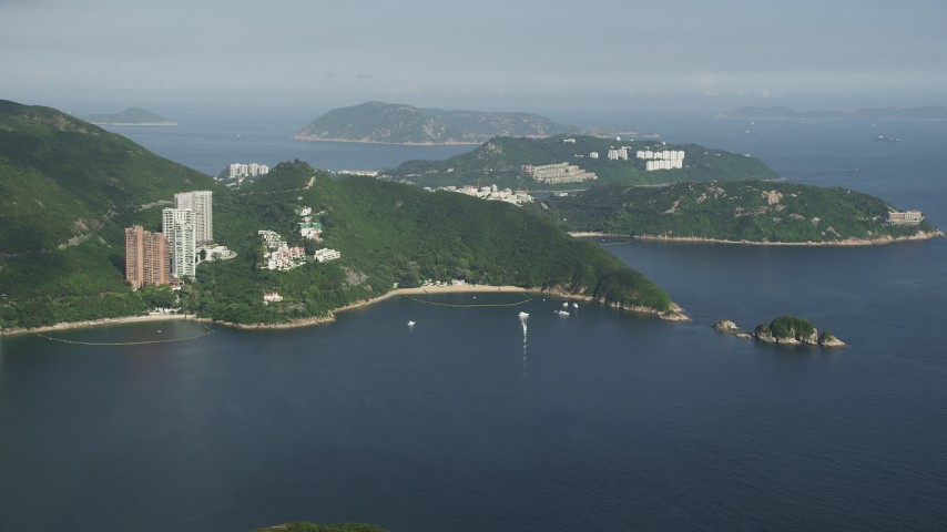Approach Hong Kong Island Waterfront Apartment Buildings from Repulse Bay in China Aerial Stock Footage | SS01_0054