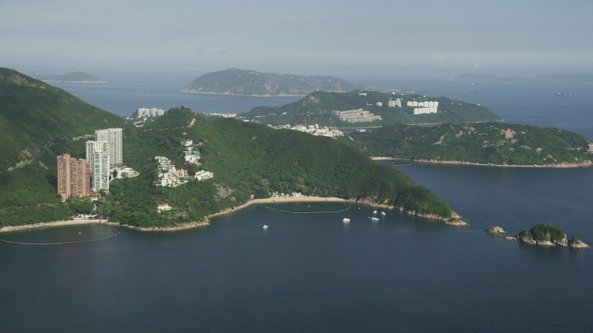5K stock footage aerial video approach Hong Kong Island waterfront apartment Buildings from Repulse Bay in China Aerial Stock Footage | SS01_0054